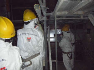 Chairman Allison Macfarlane and other NRC officials stand in the darkened interior of Reactor 4 at the Fukushima Dai-ichi nuclear complex northeast of Tokyo Dec. 13, 2012. Photo courtesy of TEPCO