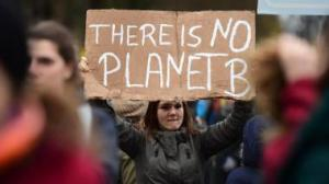 Demonstrator at the Global Climate March on Nov. 29, 2015 in Berlin, Germany. John MacDougall/AFP/Getty Images)