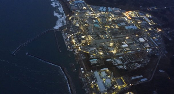 Tsunami-crippled Fukushima Daiichi nuclear power plant is illuminated for decommissioning operation in the dusk in Okuma town, Fukushima prefecture, Japan