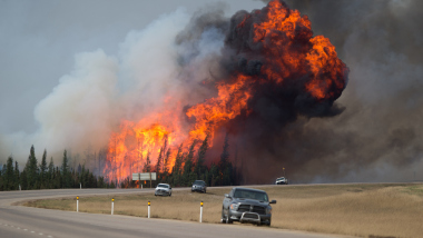 Wildfires burn in Alberta on May 7. Photo by Darryl Dyck / Bloomberg