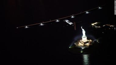 Solar Impulse 2 flies above the Statue of Liberty.