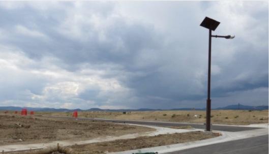 Solar-paneled street lamps line roads for future residential development near Rocky Flats by Nicolene Durham