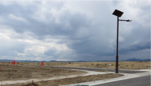 Solar-paneled street lamps line roads for future residential development near Rocky Flats by Nicolene Durham