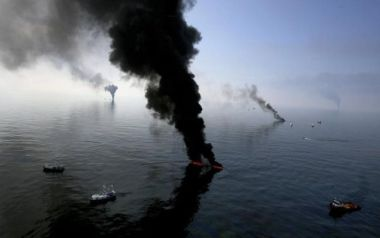 Smoke billows from a controlled burn of spilled oil. Reuters / Sean Gardner.