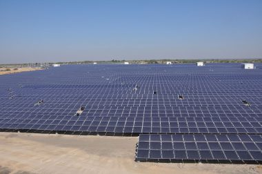 An 11.5-MW solar array in India. Photo by Citizenmj. CC BY-SA 3.0. Wikimedia Commons.