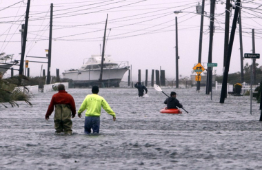 Street flooded by Hurricane Sandy, Lindenhurst, Long Island  (Photo by Jason DeCrow, CC BY SA, Wikimedia Commons)
