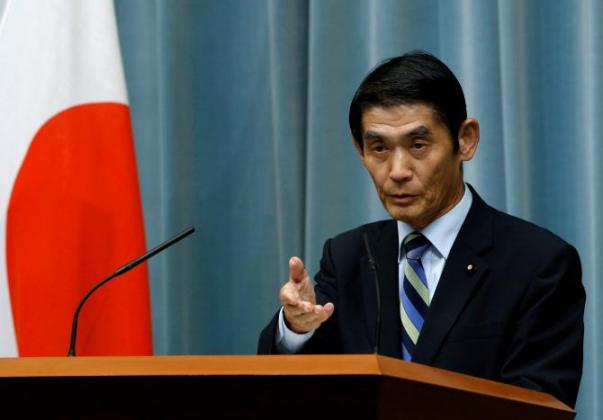 FILE PHOTO: Japan's State Minister in charge of Reconstruction Masahiro Imamura speaks at a news conference in Tokyo
