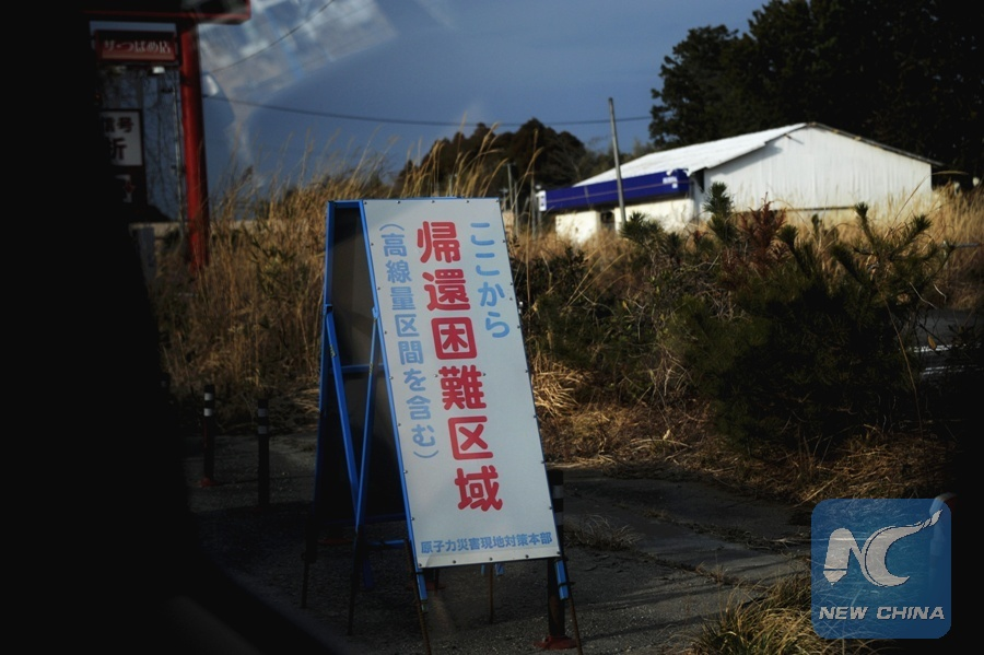 Feb. 22, 2017 shows a warning sign at Okuma near the Fukushima Daiichi.jpg